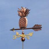Pineapple Weathervane slight left side view on dark blue sky background.