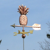 Pineapple Weathervane left side view on light blue sky background.