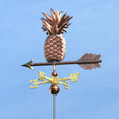 Pineapple Weathervane slight left side view on light blue sky background.