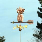 Pineapple Weathervane slight left angle view on blue sky background.