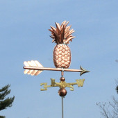 Pineapple Weathervane rear angle view on blue sky background.