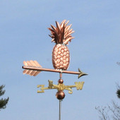Pineapple Weathervane slight right rear view on blue sky background.