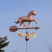 Horse Weathervane right front view on blue sky background.