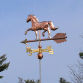 Horse Weathervane left rear view on blue sky background.