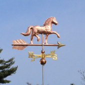 Horse Weathervane slight right angle view on blue sky background.