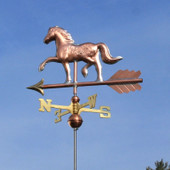 Horse Weathervane left underside view on blue sky background.