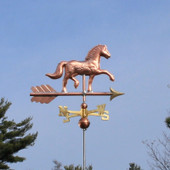 Horse Weathervane right distance view on blue sky background.