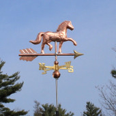 Horse Weathervane right side view on blue sky background.
