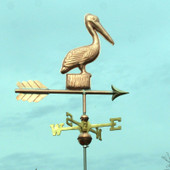 Small Pelican Weathervane standing on a Post, right rear view with a greenish sky background.