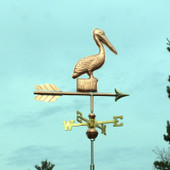 Small Pelican Weathervane standing on a Post, right rear view with a green sky background.