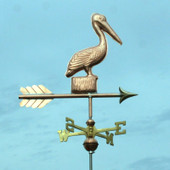 Small Pelican Weathervane standing on a Post, right angle view with a dark greenish blue sky background.