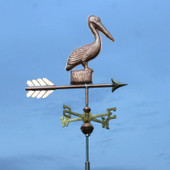 Pelican Weathervane standing on a Post, right front angle view with a dark blue sky background.