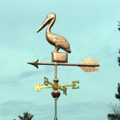 Small Pelican Weathervane standing on a Post, left front view with a greenish sky background.