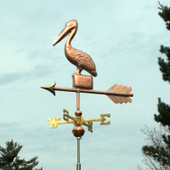Small Pelican Weathervane standing on a Post, left front angle view with a green sky background.