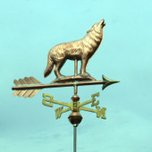 Small Wolf Weathervane standing on a rock right, side view with a greenish sky background.