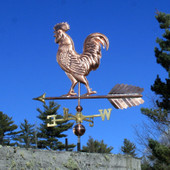 Large Walking Rooster Weathervane left rear view on blue sky background.