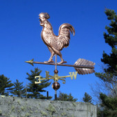 Large Walking Rooster Weathervane slight left front view on blue sky background.