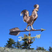 Large Walking Rooster Weathervane right front view on light  blue sky background.