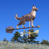 Large German Shepherd Weathervane right front view on bright blue sky background.