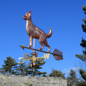 Large German Shepherd Weathervane left front view on bright blue sky background.