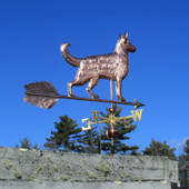 Large German Shepherd Weathervane right rear view on bright blue sky background.