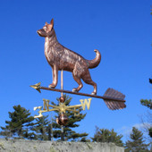 Large German Shepherd Weathervane left front angle view on blue sky background.