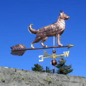 Large German Shepherd Weathervane right side view on blue sky background.