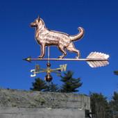 Large German Shepherd Weathervane left rear angle view on blue sky background.