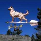 Large German Shepherd Weathervane left standing view on blue sky background.