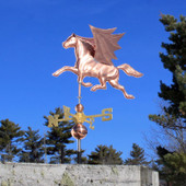 Pegasus Wind Vane with spread wings left side view on blue sky background.