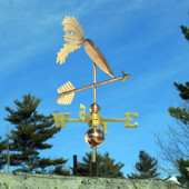 Carrot Weathervane on an arrow front view on blue sky background.