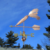 Carrot Weathervane left side view on blue sky background.