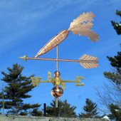 Carrot Weathervane left front view on blue sky background.