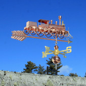 Train with Spoke Wheels Weathervane rear right side view on blue sky background.