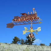 Train with Spoke Wheels Weathervane front right side view on blue sky background.