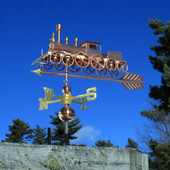 Train with Spoke Wheels Weathervane left side view on blue sky background.