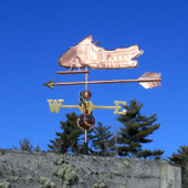 Snowmobile Weathervane right side view on blue sky background.