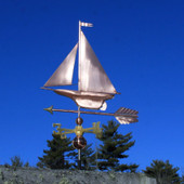 Yacht/Sailboat Weathervane left front view on blue sky background.