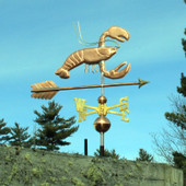 copper lobster wind vane, right side view on blue sky background.