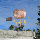Large Pumpkin Weathervane right side view on blue sky background.
