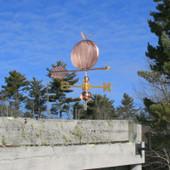 Pumpkin Weathervane on blue sky background