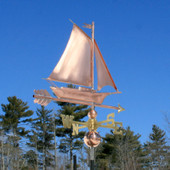 Friendship Sloop/Sailboat Weathervane right rear angle view on blue sky background.