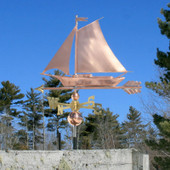 Friendship Sloop/Sailboat Weathervane angle view on blue sky background.