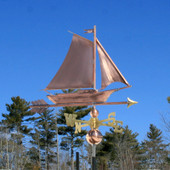 Friendship Sloop/Sailboat Weathervane front angle view on blue sky background.