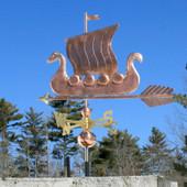 Viking Ship/Sailboat Weathervane angle view on blue sky background.