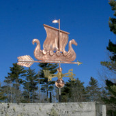 Viking Ship/Sailboat Weathervane right side view on blue sky background.