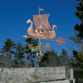 Viking Ship/Sailboat Weathervane left side view on blue sky background.