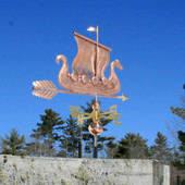 Viking Ship/Sailboat Weathervane right rear side view on blue sky background.