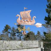 Viking Ship/Sailboat Weathervane left angle on blue sky background.