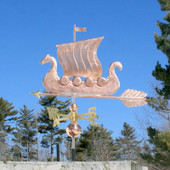 Viking Ship/Sailboat Weathervane side view on blue sky background.